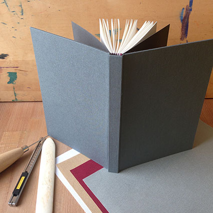 photo of case binding with cloth samples